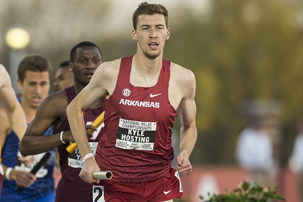 Arkansas' Kyle Hosting runs the first leg of the 4x800 meter relay during the National Relay Championships on Saturday, April 28, 2018, in Fayetteville.