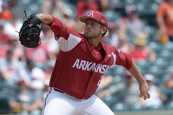 Arkansas pitcher Kacey Murphy throws during a game against Texas A&M on Saturday, May 12, 2018, in Fayetteville.