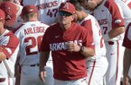 Arkansas coach Dave Van Horn walks away from a team huddle prior to a game against Texas A&M on Friday, May 11, 2018, in Fayetteville.