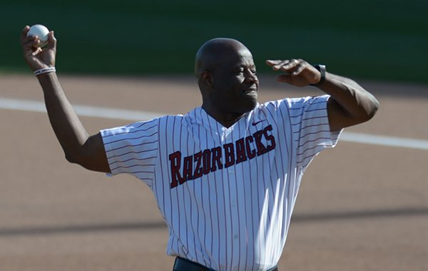 Arkansas basketball coach Mike Anderson throws out a ceremonial first pitch prior to a baseball game between Arkansas and Texas A&M on Friday, May 11, 2018, in Fayetteville.