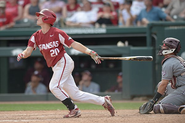 Arkansas second baseman Carson Shaddy follows through with a 2-run, RBI double to right Saturday, May 12, 2018, during the seventh inning against Texas A&M at Baum Stadium in Fayetteville.