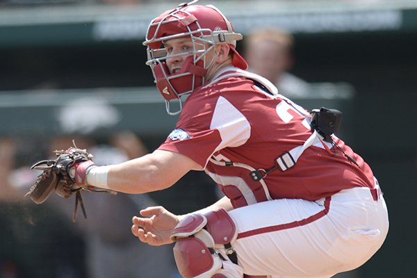 Arkansas catcher Grant Koch touches home plate during a game against Texas A&M on Saturday, May 12, 2018, in Fayetteville.