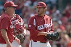 Arkansas pitcher Kacey Murphy walks off the mound while coach Dave Van Horn, left, looks on during a game against Texas A&M on Saturday, May 12, 2018, in Fayetteville.