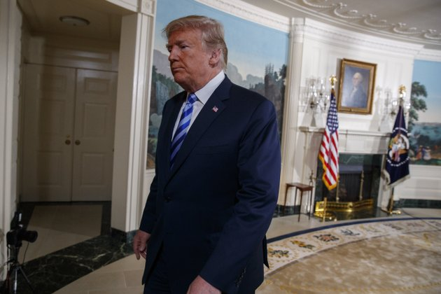 president-donald-trump-walks-off-after-delivering-a-statement-on-the-iran-nuclear-deal-from-the-diplomatic-reception-room-of-the-white-house-tuesday-may-8-2018-in-washington-trump-says-the-united-states-is-withdrawing-from-the-iran-nuclear-deal-which-he-called-quotdefective-at-its-corequot-ap-photoevan-vucci
