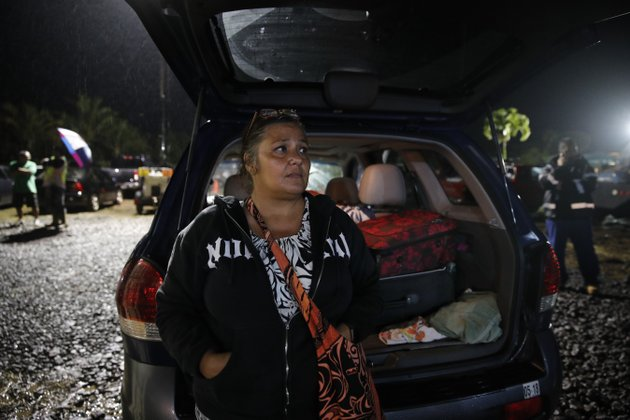 in-this-may-8-2018-file-photo-evacuee-nina-bersamina-an-elementary-school-teacher-stands-next-to-her-suv-loaded-with-her-belongings-while-waiting-to-pick-up-some-food-at-a-makeshift-donation-center-in-pahoa-hawaii-its-heartbreaking-its-heartbreaking-because-this-is-our-home-said-bersamina-ap-photojae-c-hong-file