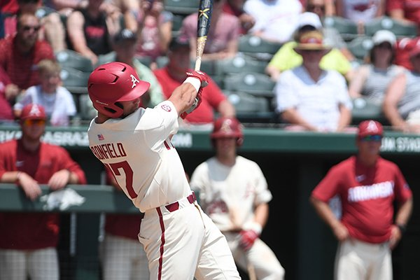 Luke Bonfield rips a home run in the third inning against Texas A&M Sunday May 13, 2018 at Baum Stadium in Fayetteville. Arkansas won 6-3 to sweep the three game series.