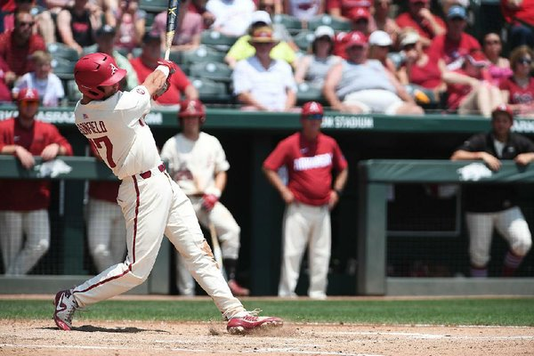 Luke Bonfield rips a home run in the third inning against Texas A&M on Sunday at Baum Stadium in Fayetteville. Bonfield drove in four runs as Arkansas won 6-3 to sweep the series.