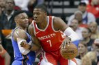 Houston Rockets guard Joe Johnson (7) drives into Oklahoma City Thunder guard Russell Westbrook (0) during the first half of an NBA basketball game Saturday, April 7, 2018, in Houston. (AP Photo/Michael Wyke)