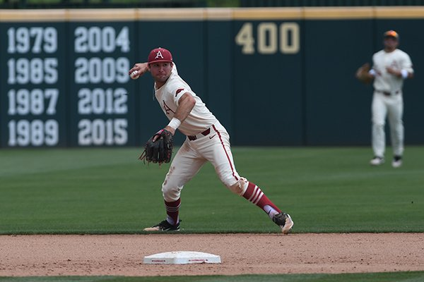 Arkansas shortstop Jack Kenley makes a throw to first base during Arkansas' 6-3 win over Texas A&M Sunday May 13, 2018 at Baum Stadium in Fayetteville.