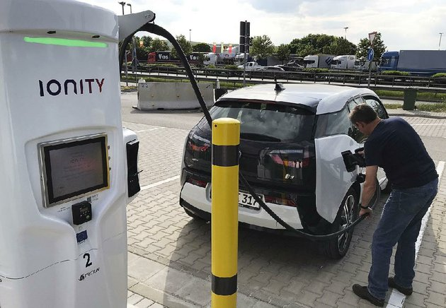 a-man-charges-his-bmw-electric-vehicle-friday-at-a-rest-stop-in-niederzissen-germany-the-fastcharging-station-for-electric-vehicles-is-run-by-ionity-a-joint-venture-of-several-automakers