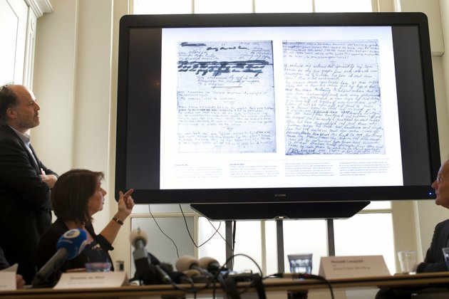 a-video-shows-the-text-underneath-two-taped-off-pages-from-anne-franks-diary-during-a-press-conference-at-the-anne-frank-foundations-office-in-amsterdam-netherlands-on-tuesday-may-15-2018