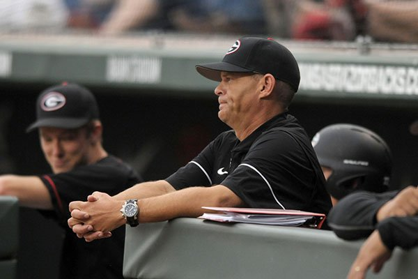 Georgia coach Scott Stricklin watches from the dugout during a game against Arkansas on Friday, April 13, 2017, in Fayetteville.