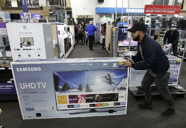 jesus-reyes-heads-for-the-checkout-on-black-friday-last-year-at-a-best-buy-store-in-overland-park-kan-the-commerce-department-reported-tuesday-that-retail-sales-rose-at-a-solid-pace-in-april