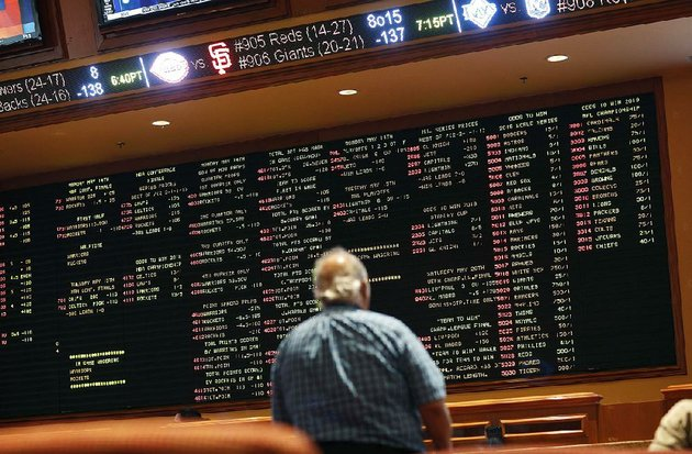 a-man-checks-out-the-sports-betting-odds-at-a-casino-in-las-vegas-on-monday-the-day-the-us-supreme-court-indicated-its-leanings-regarding-the-constitutions-10th-amendment