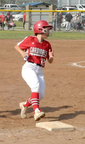 MARK HUMPHREY ENTERPRISE-LEADER Farmington sophomore Siana Sisemore comes into third base while pinch-running against Magnolia during Farmington's 5-4 Thursday win. Base running became a critical aspect of the game when the Lady Cardinals were forced to manufacture runs in a 7-0 quarterfinal win over Paragould Friday.