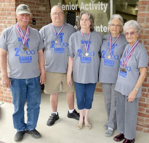 Westside Eagle Observer/RANDY MOLL Showing the medals they won at the May 4 Senior Olympics in Harrison are Johnny Burger, James Tucker, Deanne Tucker, Maxine Foster and Vel Hornberger. Members of the Gentry Senior Activity Center participated in the 34th Senior Olympics and brought back 13 medals this year.