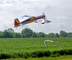 Janelle Jessen/Herald-Leader An aerobatic remote control plane owned by Jeremy Shrock of Gentry flew over the landing strip at Allen's Air Field during the Siloam Springs Radio Controlled Modelers semi-annual fun fly on Saturday.