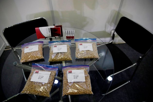file-in-this-april-12-2018-file-photo-packets-of-raw-soybeans-are-placed-on-a-table-at-a-us-soybean-companys-booth-at-the-international-soybean-exhibition-in-shanghai-china-with-the-threat-of-tariffs-and-counter-tariffs-between-washington-and-beijing-looming-chinese-buyers-are-canceling-orders-for-us-soybeans-a-trend-that-could-deal-a-blow-to-american-farmers-if-it-continues-at-the-same-time-farmers-in-china-are-being-encouraged-to-plant-more-soy-apparently-to-help-make-up-for-any-shortfall-from-the-united-states-ap-photoandy-wong-file