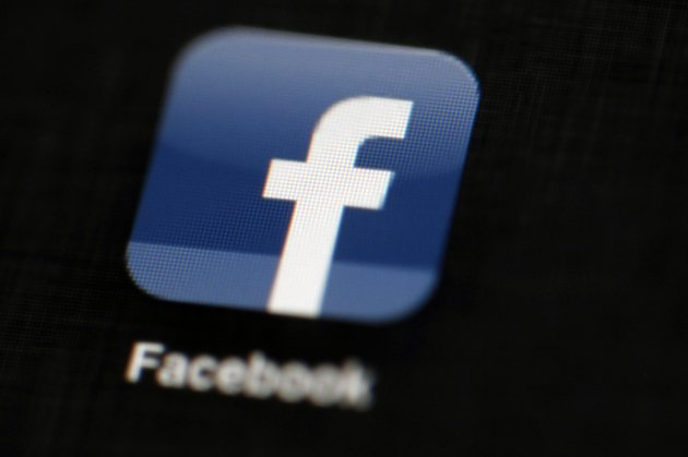 file-in-this-may-16-2012-file-photo-the-facebook-logo-is-displayed-on-an-ipad-in-philadelphia-facebook-believes-its-policing-system-is-better-at-scrubbing-graphic-violence-gratuitous-nudity-and-terrorist-propaganda-from-its-social-network-than-it-is-at-removing-racist-sexist-and-other-hateful-remarks-the-self-assessment-on-tuesday-may-15-2018-came-three-weeks-after-facebook-tried-to-give-a-clearer-explanation-of-the-kinds-of-posts-that-it-wont-tolerate-ap-photomatt-rourke-file