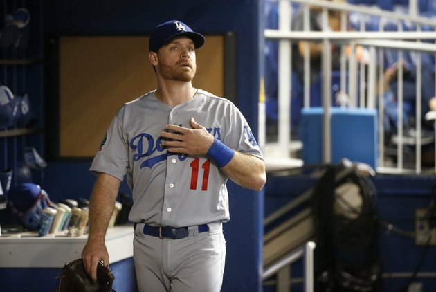 los-angeles-dodgers-logan-forsythe-looks-out-of-the-dugout-before-the-teams-game-against-the-miami-marlins-tuesday-may-15-2018-in-miami-the-slumping-dodgers-have-activated-third-baseman-justin-turner-and-second-baseman-forsythe-from-the-10-day-disabled-list-and-both-are-in-the-lineup-for-their-game-at-miami-ap-photowilfredo-lee