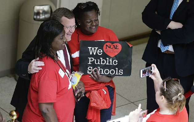 tim-moore-speaker-of-the-north-carolina-house-of-representatives-poses-with-teachers-wednesday-during-a-teachers-rally-at-the-capitol-in-raleigh