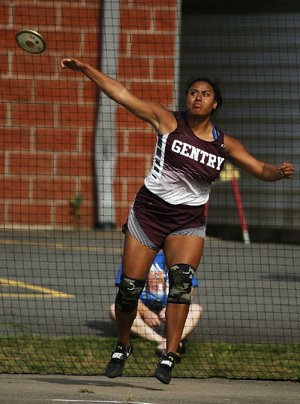 Gentry's Chastery Fuamatu throws a discus Wednesday during the state high school heptathlon in Cabot. Fuamatu set the state record with a throw of 126 feet, 11½ inches in the event.