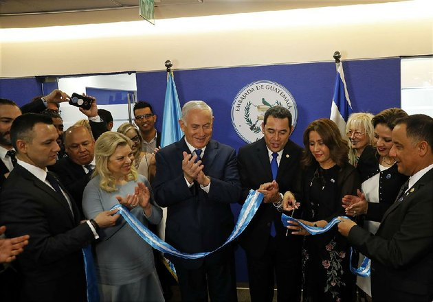 israeli-prime-minister-benjamin-netanyahu-third-from-left-his-wife-sara-beside-him-and-guatemalan-president-jimmy-morales-center-watch-wednesday-as-morales-wife-hilda-patricia-marroquin-cuts-the-ribbon-dedicating-the-guatemalan-embassy-in-jerusalem