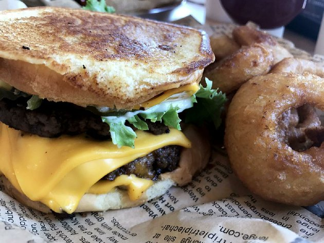 the-cheeeesy-burger-served-here-with-onion-rings-has-not-just-four-es-but-four-slices-of-cheese-at-wayback-burgers-in-little-rock