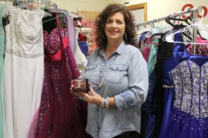 MEGAN DAVIS/MCDONALD COUNTY PRESS Susan Fickle stands amid sharp tuxes and glittering gowns in the high school counselor's office turned evening wear boutique.