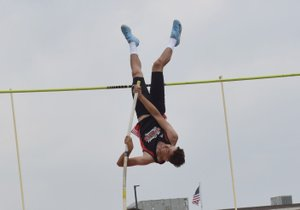RICK PECK/SPECIAL TO MCDONALD COUNTY PRESS Zack Woods goes inverted on his way to clearing 13-3 to take second place in the pole vault at the Missouri Class 4 District 6 Track and Field Championships on May 12 at Carl Junction High School.