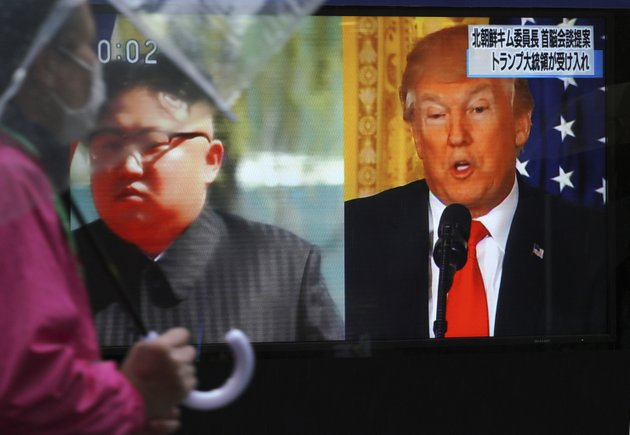 file-in-this-march-9-2018-file-photo-a-man-walks-past-a-public-tv-screen-showing-north-korean-leader-kim-jong-un-left-and-us-president-donald-trump-right-in-tokyo-pyongyangs-threat-to-scrap-the-june-12-historic-summit-with-washington-provides-a-fresh-reminder-of-the-many-false-starts-and-failures-that-shattered-previous-diplomatic-attempts-to-resolve-the-nuclear-standoff-ap-photoeugene-hoshiko