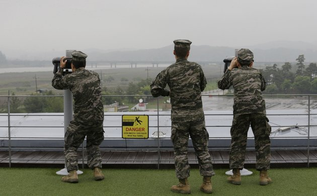 south-korean-marine-force-members-look-toward-norths-side-through-binoculars-at-the-imjingak-pavilion-in-paju-near-the-border-village-of-panmunjom-south-korea-wednesday-may-16-2018-north-korea-on-wednesday-canceled-a-high-level-meeting-with-south-korea-and-threatened-to-scrap-a-historic-summit-next-month-between-us-president-donald-trump-and-north-korean-leader-kim-jong-un-over-military-exercises-between-seoul-and-washington-that-pyongyang-has-long-claimed-are-invasion-rehearsals-ap-photoahn-young-joon