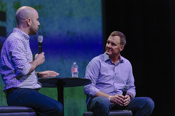 Arkansas football coach Chad Morris, right, listens while Cross Church Fayetteville pastor Nick Floyd speaks during an event Tuesday, May 15, 2018, in Fayetteville.