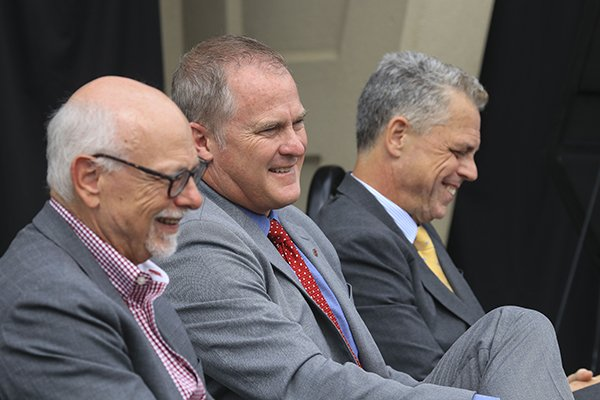 from-left-university-of-arkansas-chancellor-joseph-steinmetz-ua-athletics-director-hunter-yurachek-and-arkansas-parks-and-tourism-executive-director-kane-webb-sit-during-a-press-conference-thursday-may-17-2018-at-war-memorial-stadium-in-little-rock