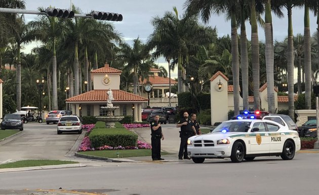 police-respond-to-the-trump-national-doral-resort-after-reports-of-a-shooting-inside-the-resort-friday-may-18-2018-in-doral-fla-a-man-shouting-about-donald-trump-entered-the-presidents-south-florida-golf-course-early-friday-draped-a-flag-over-a-lobby-counter-and-exchanged-fire-with-police-before-being-arrested-police-said-one-officer-received-an-unspecified-injury-officials-said-ap-photofrieda-frisaro