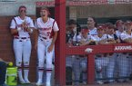 Arkansas pitcher Autumn Storms (9) leads a cheer from the dugout during a NCAA regional game against DePaul on Friday, May 18, 2018, in Fayetteville.