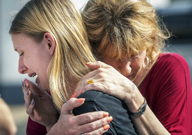 dakota-shrader-a-student-at-santa-fe-high-school-in-santa-fe-texas-is-comforted-friday-by-her-mother-susan-davidson-after-the-shooting-at-the-school-shrader-said-a-friend-was-one-of-those-who-was-shot