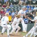 Springdale Har-Ber second baseman Blaze Brothers tackles pitcher Blake Adams as Har-Ber players cele...