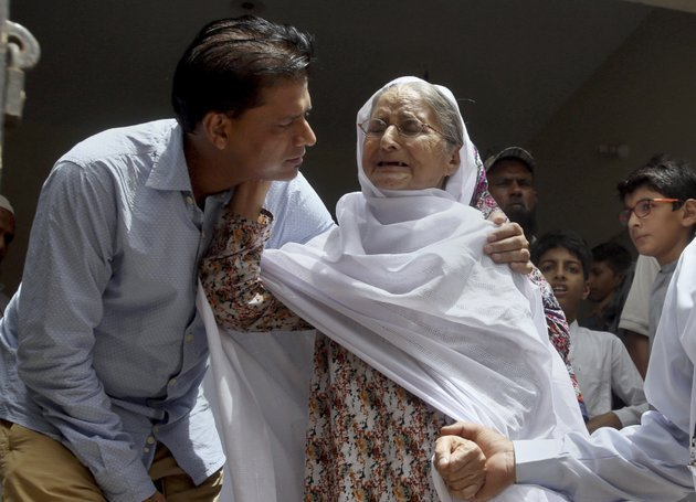 abdul-aziz-sheikh-left-father-of-sabika-sheikh-a-victim-of-a-shooting-at-a-texas-high-school-comforts-to-an-elderly-woman-arriving-for-condolence-to-his-daughter-at-his-home-in-karachi-pakistan-saturday-may-19-2018-the-pakistani-foreign-exchange-student-is-among-those-killed-in-the-shooting-according-to-a-leader-at-a-program-for-foreign-exchange-students-and-the-pakistani-embassy-in-washington-dc-megan-lysaght-manager-of-the-kennedy-lugar-youth-exchange-study-abroad-program-yes-sent-a-letter-to-students-in-the-program-confirming-that-sabika-sheikh-was-killed-in-the-shooting-ap-photofareed-khan