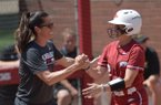 Arkansas coach Courtney Deifel congratulates shortstop A.J. Belans after Belans hit a solo home run Saturday, May 19, 2018, during the fifth inning against Wichita State at Bogle Park during the NCAA Fayetteville Softball Regional on the university campus in Fayetteville.