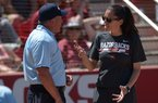 Arkansas coach Courtney Deifel argues with plate umpire Steve McCown after a runner was called out for leaving third early on a fly ball out Saturday, May 19, 2018, to end the seventh inning against Wichita State at Bogle Park during the NCAA Fayetteville Softball Regional on the university campus in Fayetteville.