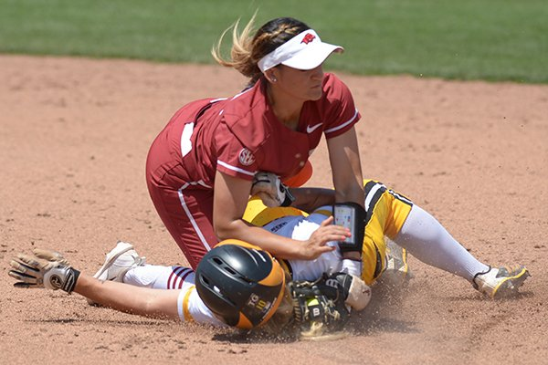 Arkansas second baseman Haydi Bugarin (top) collides with Wichita State third baseman Mackenzie Wright Saturday, May 19, 2018, as Wright comes in safely at the bag during the third inning at Bogle Park during the NCAA Fayetteville Softball Regional on the university campus in Fayetteville.