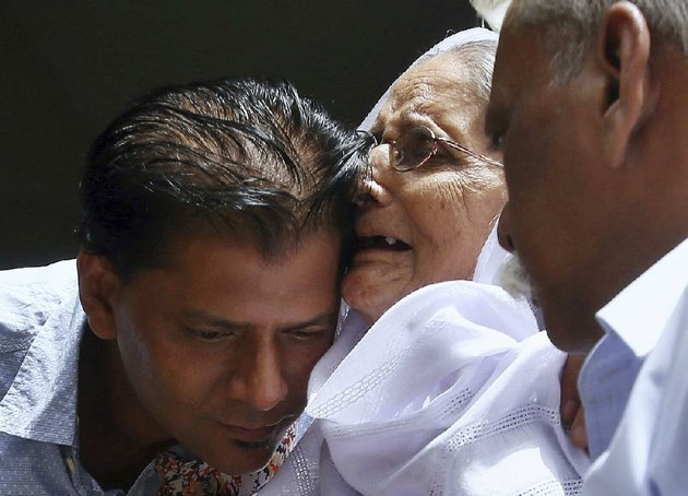 aziz-sheikh-hugs-a-woman-sharing-condolences-saturday-at-his-home-in-islamabad-over-the-shooting-death-of-his-daughter-sabika-sheikh-sheikh-said-he-found-out-about-her-death-after-seeing-news-reports-and-trying-repeatedly-to-reach-her-on-her-phone