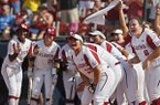 Oklahoma players celebrate at home plate as they wait for Nicole Pendley following a home run by Pendley against Baylor in the third inning during the championship game of the Big 12 softball tournament in Oklahoma City, Saturday, May 12, 2018. (AP Photo/Sue Ogrocki)