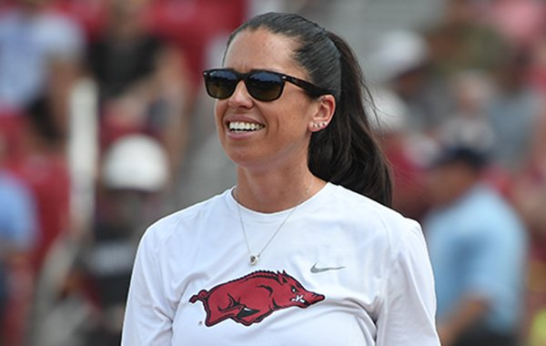 Arkansas coach Courtney Deifel looks into the outfield during the Razorbacks' game against Wichita State Sunday May 20, 2018 at Bogle Park in Fayetteville. Arkansas won 6-4 and advanced to its first super regional.