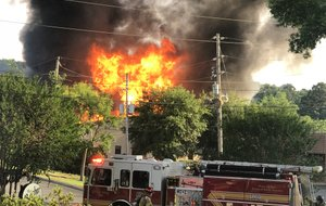 Firefighters respond to a blaze in west Little Rock on Sunday, May 20, 2018.