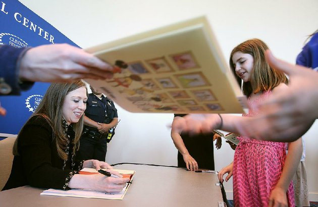chelsea-clinton-left-signs-a-copy-of-her-book-she-persisted-around-the-world-for-hannah-cherepski-right-10-after-clinton-spoke-sunday-at-the-statehouse-convention-center-in-little-rock