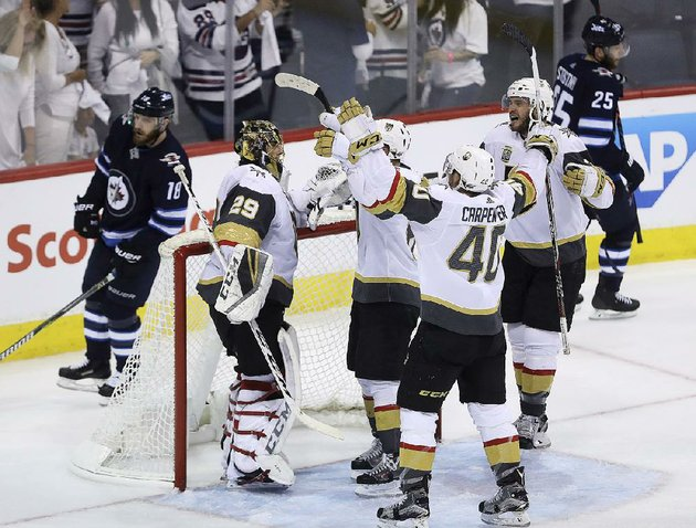 vegas-golden-knights-players-congratulate-goaltender-marc-andre-fleury-left-after-sundays-2-1-victory-over-the-winnipeg-jets-in-game-5-of-the-nhl-western-conference-fi-nals-sunday-in-winnipeg-the-expansion-golden-knights-won-the-series-4-1-to-advance-to-the-stanley-cup-fi-nal