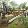 A crew from the Benton County Road Department replaces drainage culverts Thursday, May 10, 2018, alo...