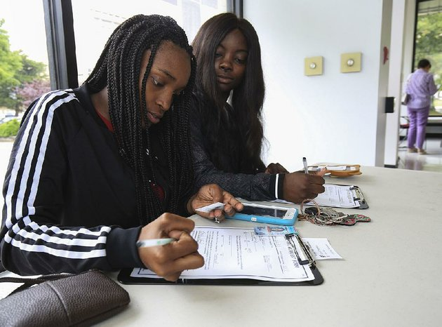 natesha-robinson-left-and-khambria-allen-fill-out-early-voting-request-forms-monday-at-the-pulaski-county-regional-building-in-little-rock-monday-was-the-last-day-of-early-voting-for-todays-party-primary-election-and-nonpartisan-judicial-general-election